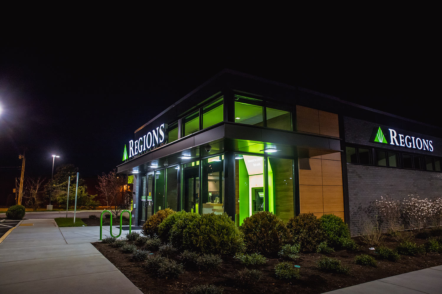 regions-new-build-psco-exterior-signage-night-illuminated-2